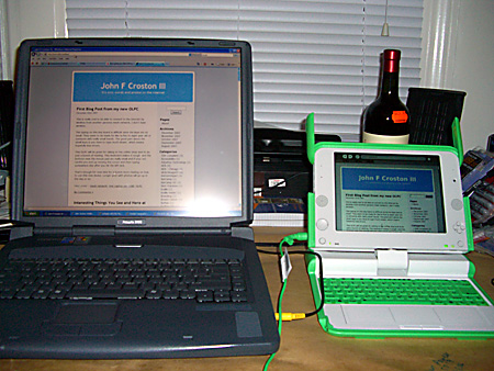 My new One Laptop per Child (OLPC) next to my older 16 inch laptop